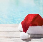 46808065 - red christmas hat sitting by the pool